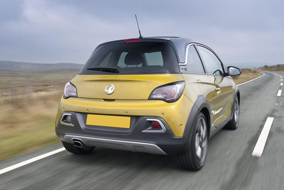 The exterior of a yellow Vauxhall Adam