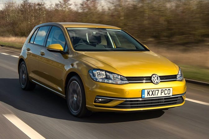The front exterior of a gold Volkswagen Golf