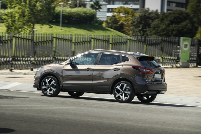 The side exterior of a brown Nissan Qashqai