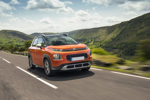 The front exterior of an orange Citroen C3 Aircross
