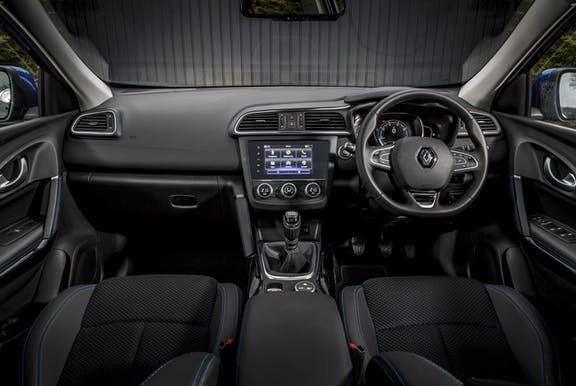 The interior of a Renault Kadjar with steering wheel and dashboard in shot