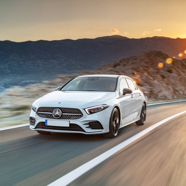 The front exterior of a white Mercedes-Benz A-Class