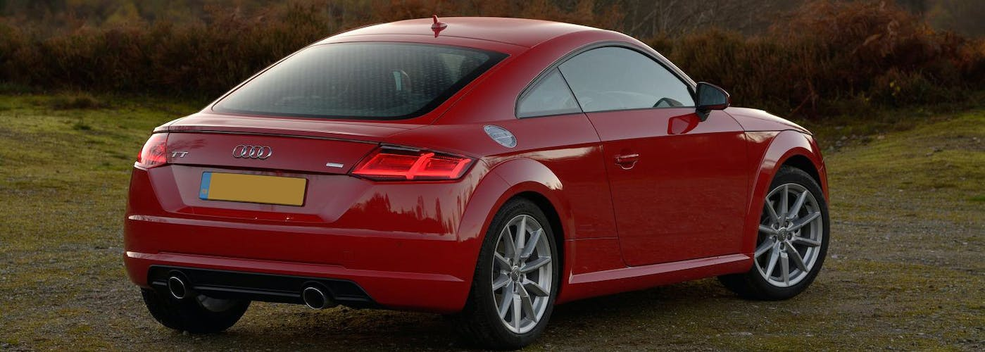 The rear exterior of a red Audi TT