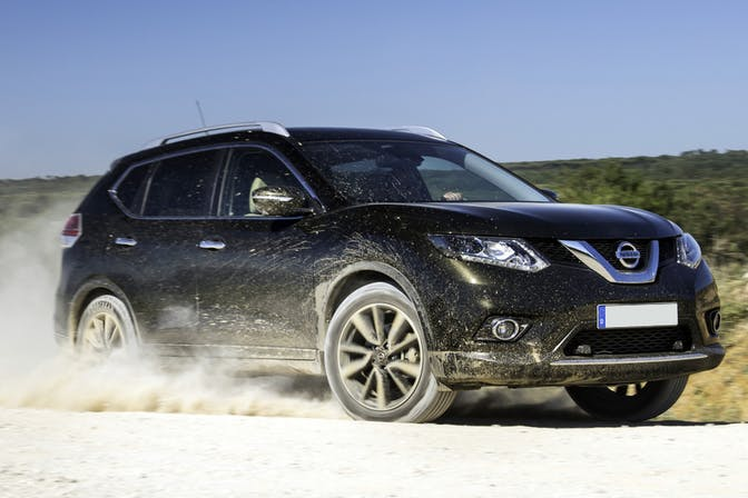 The front exterior of a black Nissan X-Trail