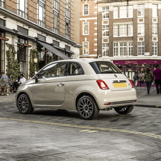 The rear exterior of a white Fiat 500