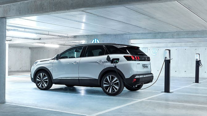The side exterior of a white Peugeot 3008