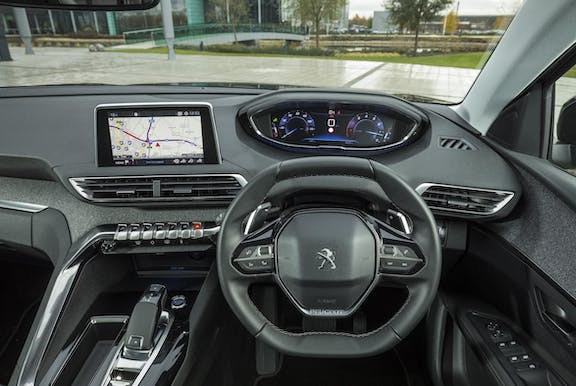 The interior of a Peugeot 3008 with steeringwheel and dashboard in shot