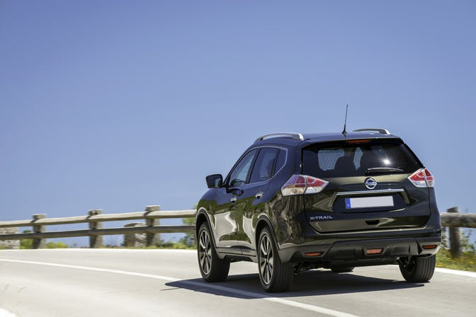 The rear exterior of a black Nissan X-Trail