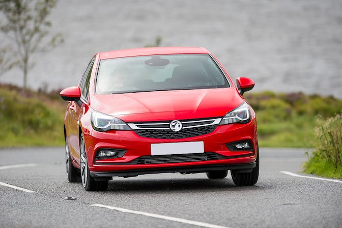 The front exterior of a red Vauxhall Astra