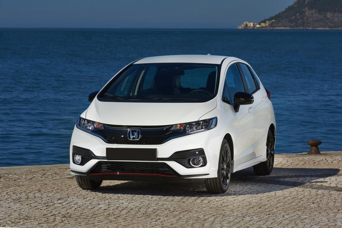 The exterior of a white Honda Jazz