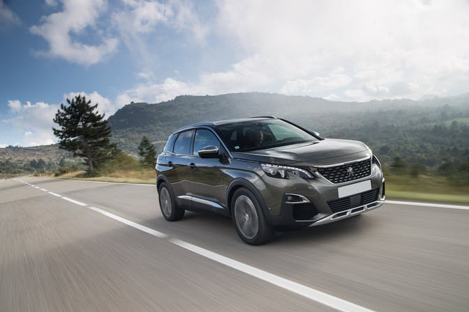 The front exterior of a black Peugeot 3008