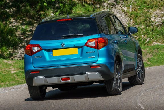 The rear exterior of a blue Suzuki Vitara