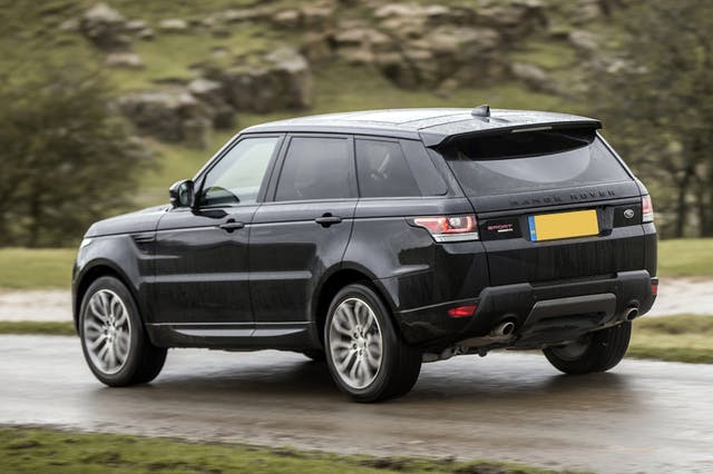 The rear exterior of a black Land Rover Range Rover Sport
