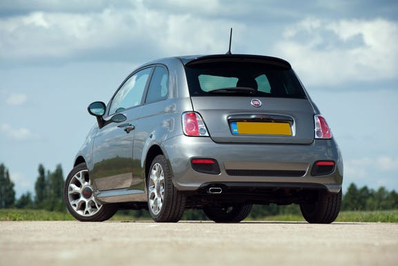 The rear exterior of a silver Fiat 500