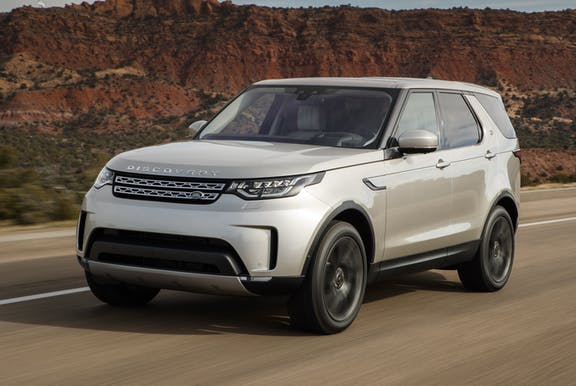 The front exterior of a silver Land Rover Discovery