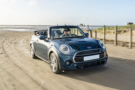 The front exterior of a blue Mini Convertible
