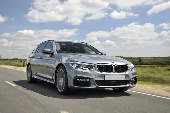 The exterior of a silver BMW 5 Series