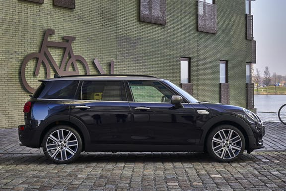 The side exterior of a black Mini Clubman