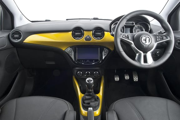 The interior of a Vauxhall Adam with steeringwheel and dashboard in shot