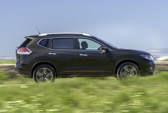 The side exterior of a black Nissan X-Trail