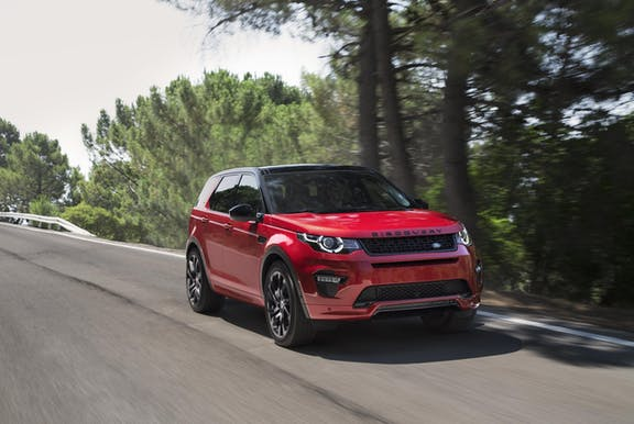 The front exterior of a red Land Rover Discovery Sport