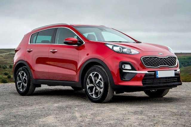 The exterior of a red Kia Sportage