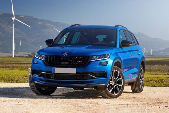 The front exterior of a blue Skoda Kodiaq