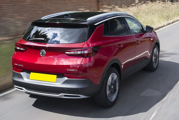 The rear exterior of a red Vauxhall Grandland X