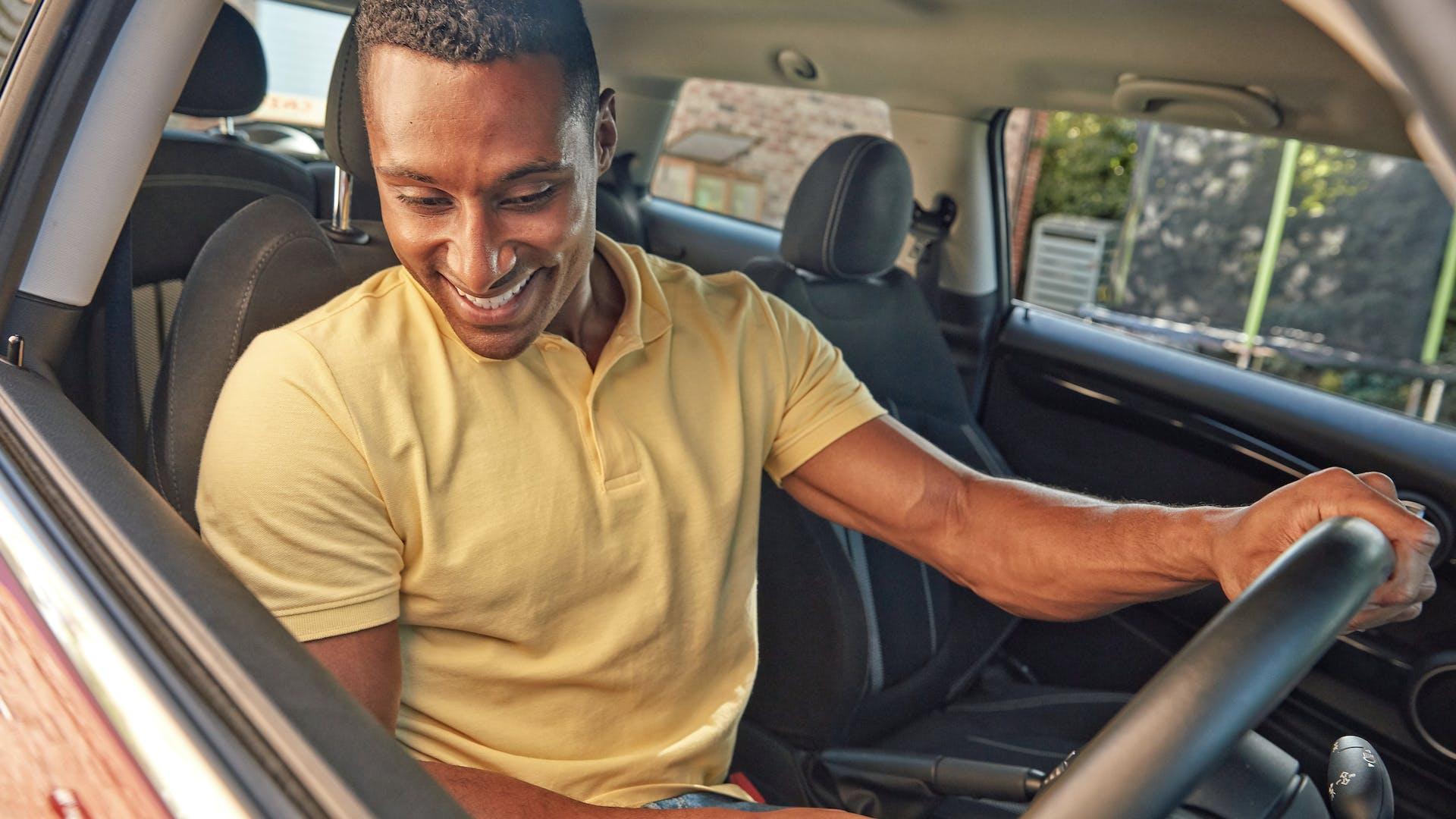 Happy Cazoo customer driving a used car
