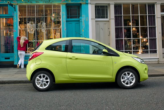 The side exterior of a green Ford Ka