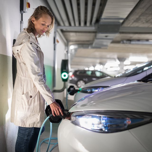 An electric car being charged up