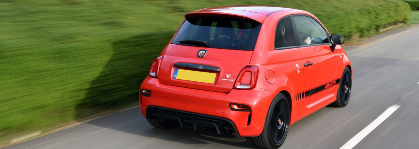 The rear exterior of a red Abarth 595