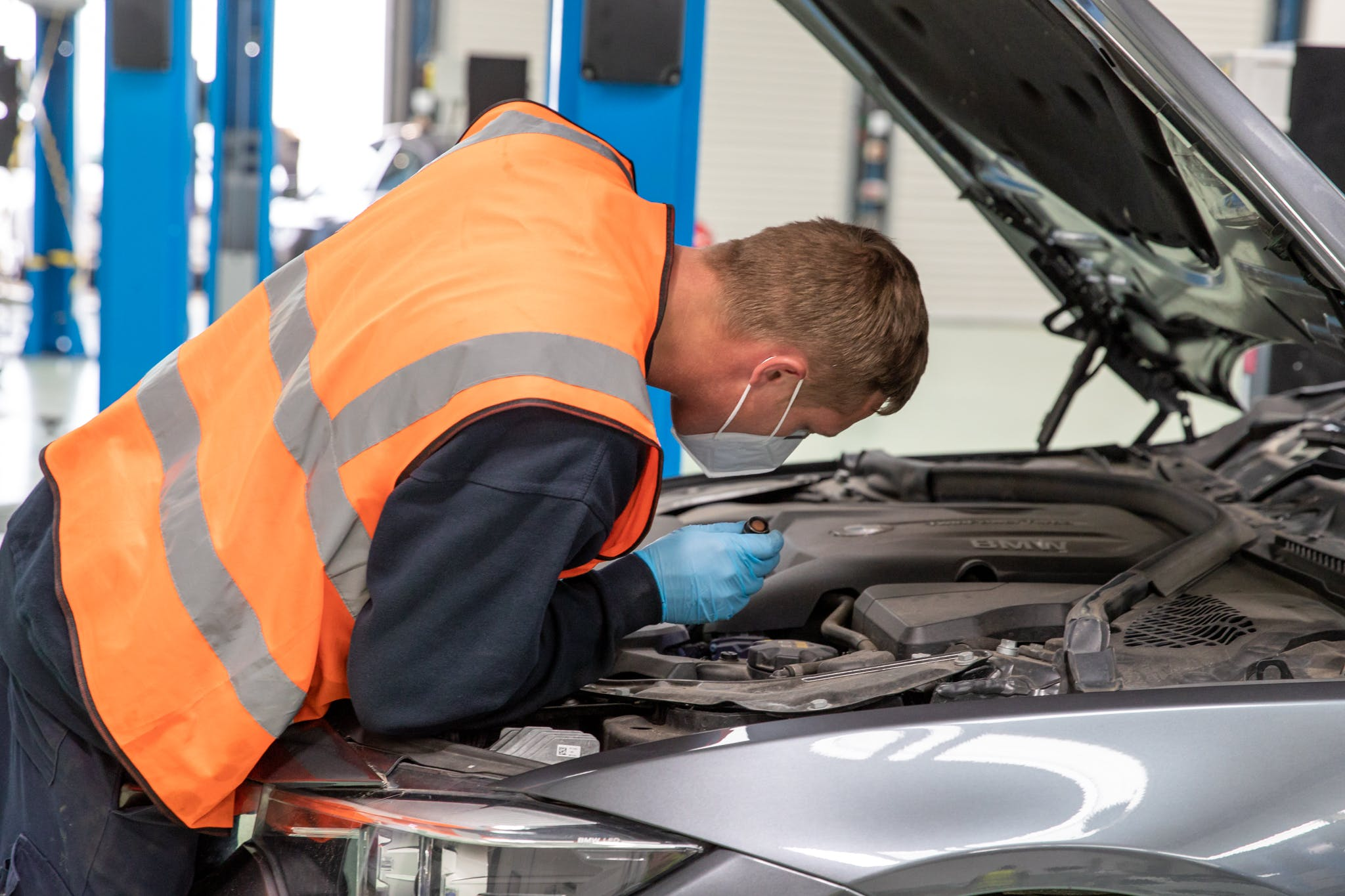 Man inspecting a Cazoo car