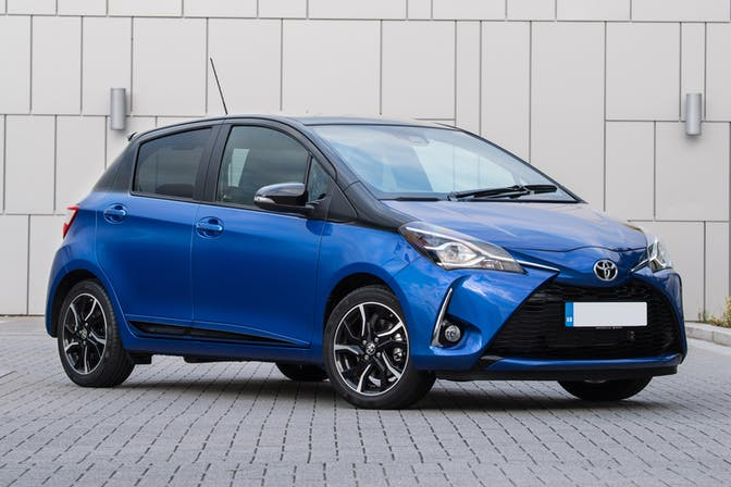 The exterior of a blue Toyota Yaris
