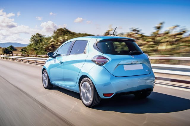 The rear exterior of a blue Renault Zoe