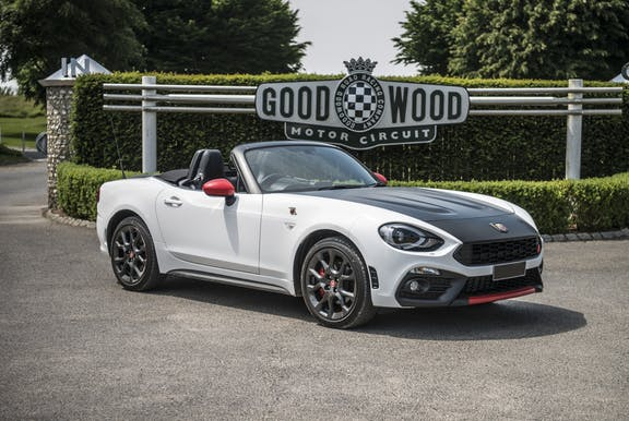 The front exterior of a white Abarth 124 Spider