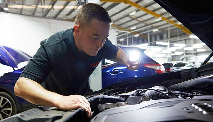 Man inspecting car engine