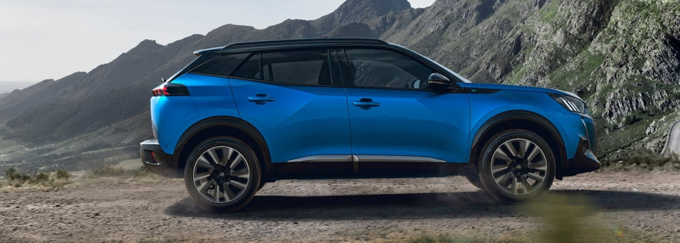 The side exterior of a blue Peugeot 2008
