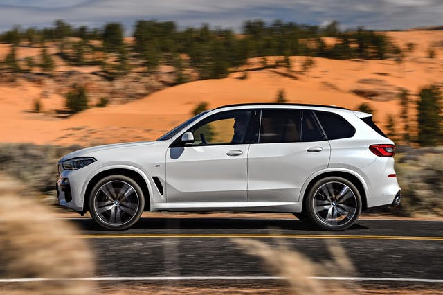 The side exterior of a white BMW X5