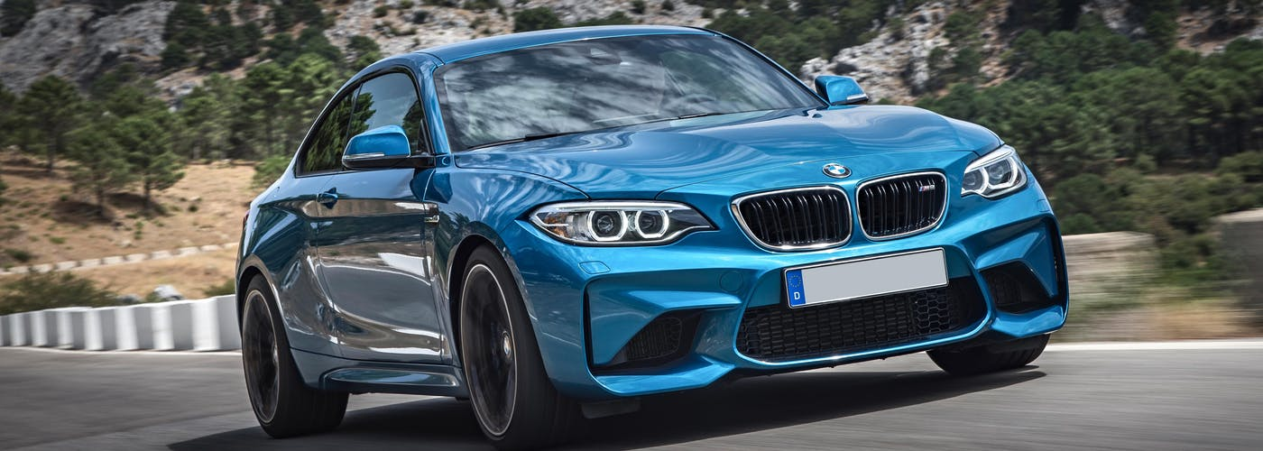 The front exterior of a blue BMW M2
