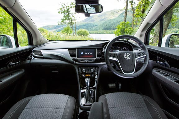 The interior of a Vauxhall Mokka X with steeringwheel and dashboard in shot