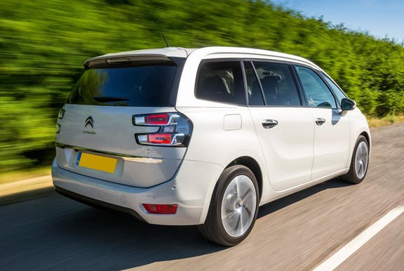 The rear exterior of a white Citroen Grand C4 Picasso