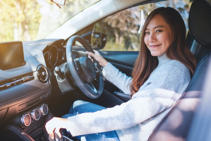 Smiling woman driving a car