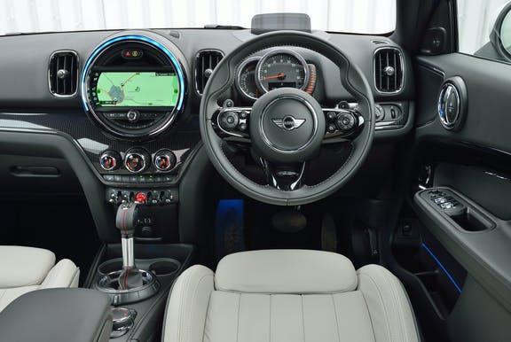 The interior of a Mini Countryman with steeringwheel and dashboard in shot