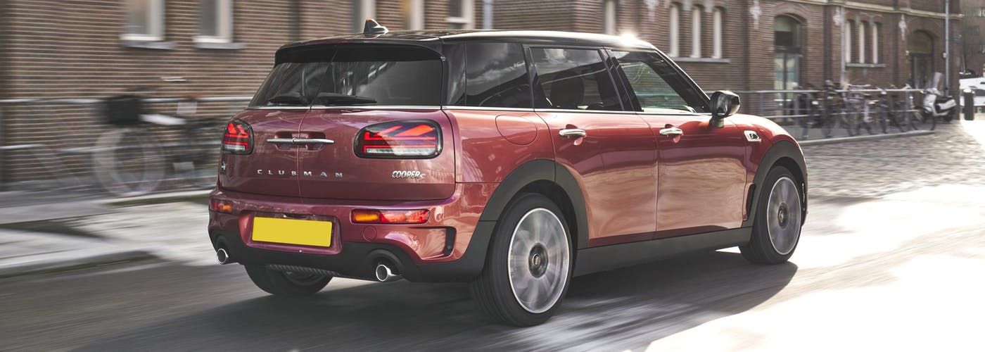 The rear exterior of a red Mini Clubman