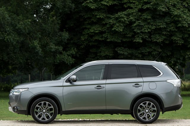 The side exterior of a silver Mitsubishi Outlander