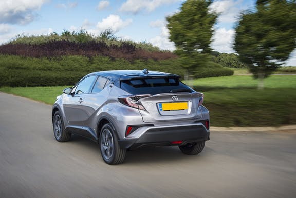 The rear exterior of a silverToyota C-HR