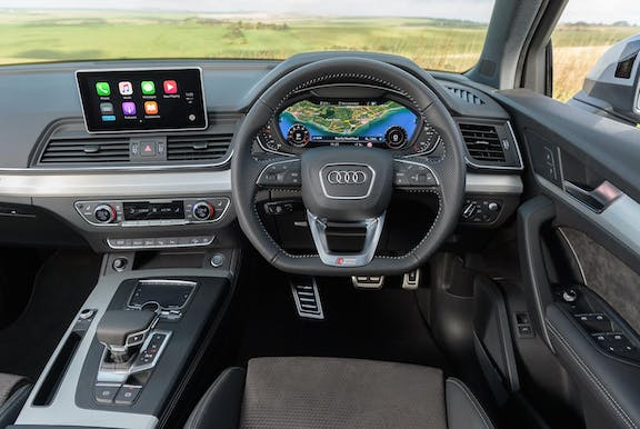 The interior of an Audi Q5 shot with dashboard and wheel