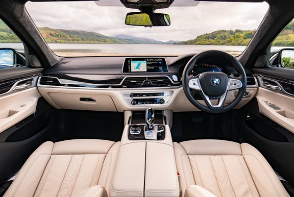 The interior of a BMW 7 Series with wheel and dashboard