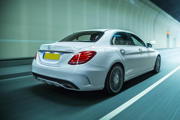 The rear exterior of a white Mercedes-Benz C-Class